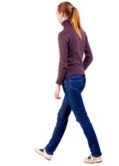 back view of walking  woman  in  sweater . beautiful blonde girl in motion.  backside view of person.  Rear view people collection. Isolated over white background.