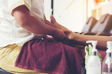 Thai foot massage alternative medicine therapy with Thai herb ar