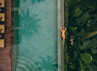 Woman relaxing on poolside