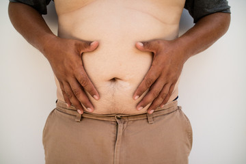 the man open the belly fat