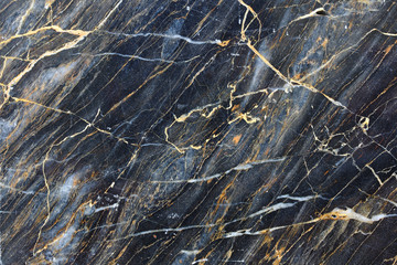 Yellow pattern in dark gray marble texture.