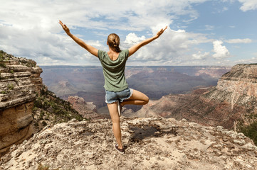 Freedom Girl with hands up on top of the Mountain, Grand Canyon south rim, Arizona, USA