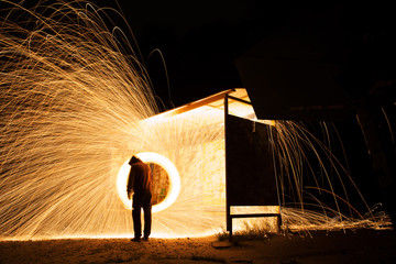 Steel wool spinning, fire shower concept abstract background