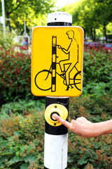 Hand pressing bicycle sign on the bicycle lane, Amsterdam.Netherlands.