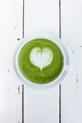 A cup of green tea matcha latte on white background