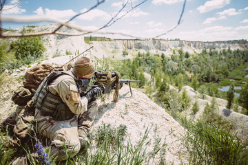 Army sniper during the military operation in the mountain.