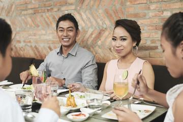 Portrait of Asian parents and children having dinner together