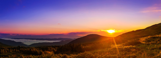 Picturesque sunrise, morning dawn in Carpathian mountains, panor