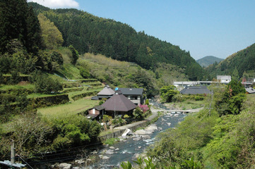 This scenery is one of the typical Japanese mountain village. This photo was taken  in April. The house has built beside of a small river stream.