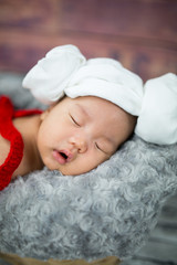 6 week old newborn boy sleeping in a basket