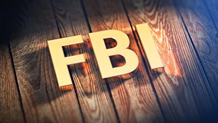 Acronym FBI on wood planks