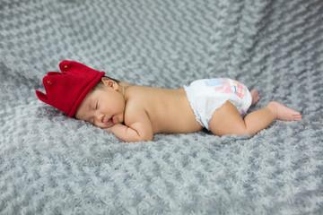 newborn baby is lying on fabric gray,6 week old