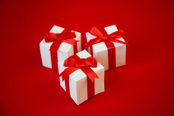 Big white gift box with beauty red ribbon bow