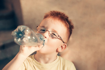 Cute baby boy drinks water