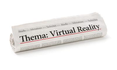 Zeitungsrolle mit der Überschrift Virtual Reality