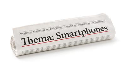 Zeitungsrolle mit der Überschrift Smartphones