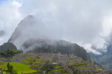 MACHU PICCHU, CUSCO REGION, PERU- JUNE 4, 2013: Panoramic view of the 15th-century Inca citadel Machu Picchu, UNESCO World Heritage Site