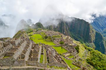 MACHU PICCHU, CUSCO REGION, PERU- JUNE 4, 2013: Panoramic view of the 15th-century Inca citadel Machu Picchu, UNESCO World Heritage Site