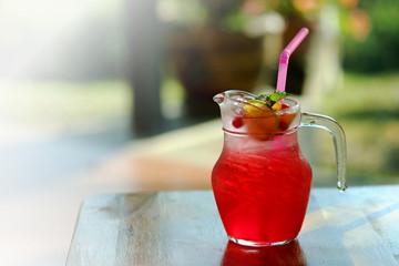 cool red pomegranate soda Serve in jar with garden restaurant background