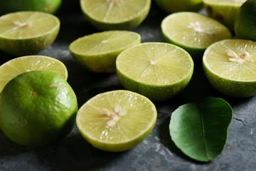 fresh limes on dark background