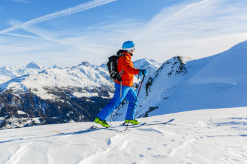 Ski touring in high mountains in fresh powder snow. Snow mountai