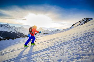 Ski touring in high mountains in fresh powder snow. Snow mountai