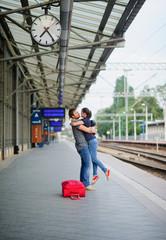 Joyful meeting at the railway station.