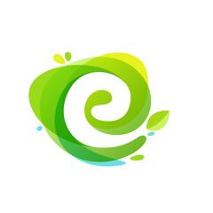 Letter E logo at green watercolor splash background.
