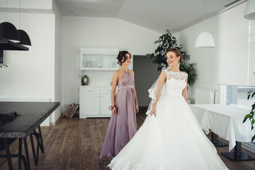 Amazing bride and her  bridesmaid poses for camera