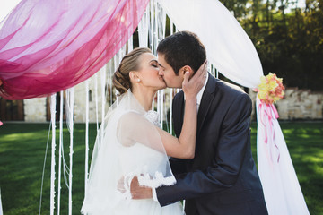 Bride and her husband kissing each other