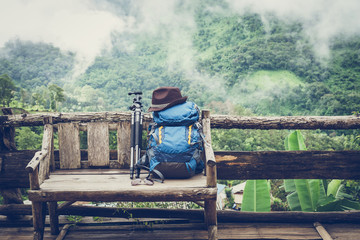 Travel backpack on the wooden bench