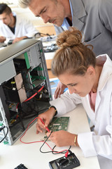 Student and teacher in electrical engineering course