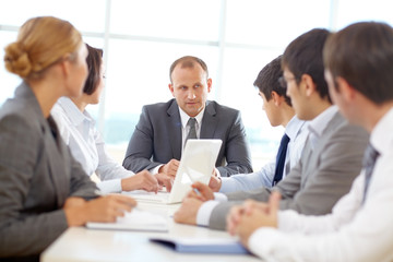 Confident team of business people planning at a meeting