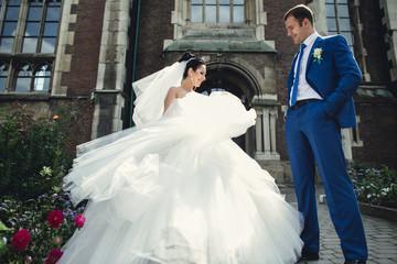 groom admiring his  incredible wife