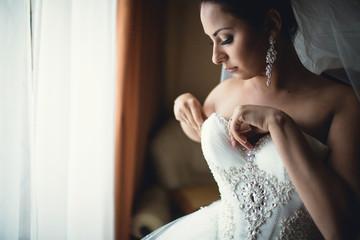 bride puts his stunning dress