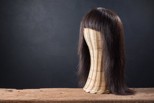 genuine hair wig with weave mannequin on old wood and art dark background