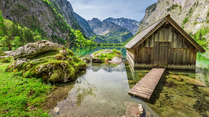 Little hut at the lake Obersee in Alps