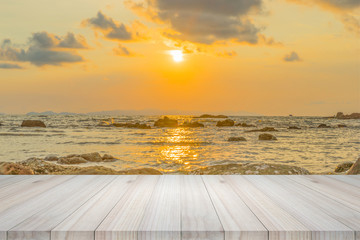 Empty wooden table or shelf wall with  sunset or sunrise on sand