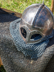 medieval knight chain mail suit and helmet