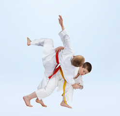 Sportsmen are training judo throws