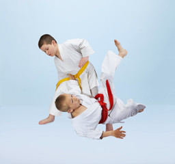 Two karateka boys are training throws