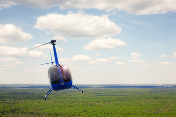 Aircraft - Helicopter flight against the background of the cloud