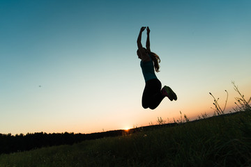 Happy woman jumping outdoor