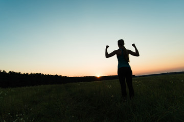 Runner woman raising arms up, success concept