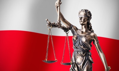 Themis with scale, symbol of justice on Polish flag background
