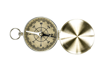 Old brass compass on white background