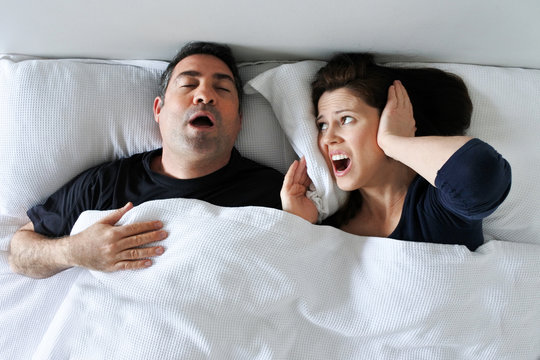 Woman suffers from her partner snoring in bed