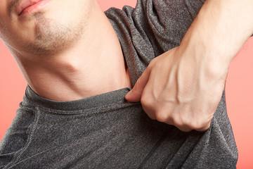 hand grabbing man shirt