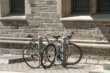 Two bikes parked next to old stone vintage house