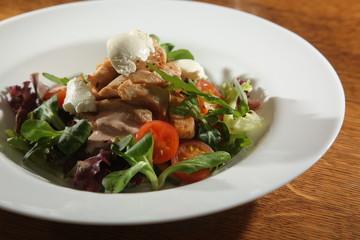 Salad with Arugula and pork